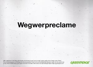 """Inzending Greenpeace: """"Trek deze advertentie uit de krant en gooi 'm in je tuin! Twee krantenpagina's vol biologische bloemenzaadjes. Goed voor een fleurig perkje bloemen."""""""